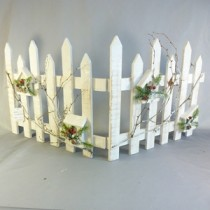 WHITE WOODEN PICKET FENCE WITH BERRY SPRAY